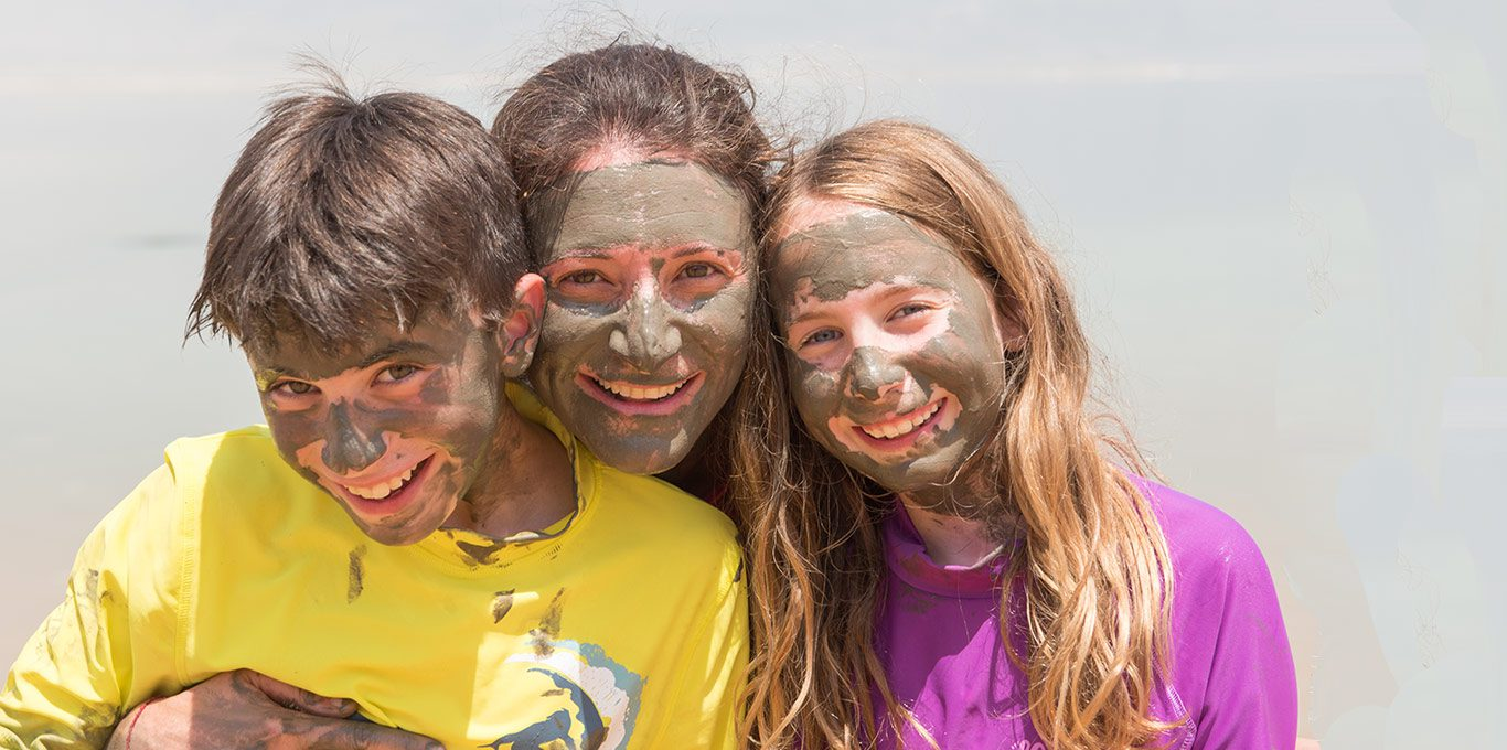 mother-son-daughter-dead-sea-mud-on-face