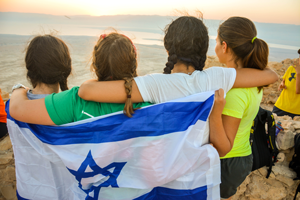 Teens wrapped in an Israeli flag.